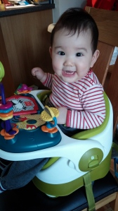toothy grin in his new chair